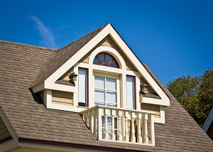 A prominent dormer balcony in the Victorian style.